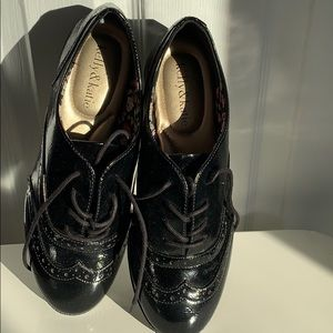 Never worn black patent leather size 7